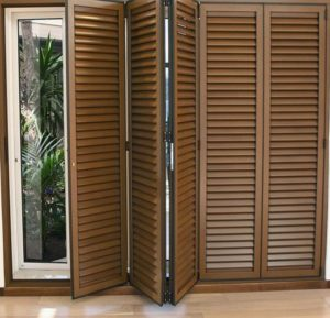 Attractive CUSTOM LOUVERED DOORS INSTALLED TO BLOCK VIEW